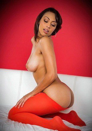 Amazingly sexy latina babe slipping off her red pantyhose and posing nude