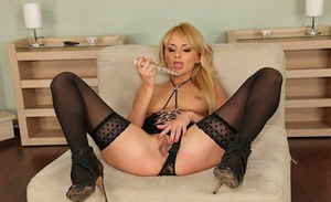 European chick Ivana Sugar stuffing her asshole with a ribbed glass dildo