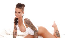 Tattooed knockout Christy Mack uncovering her flalwless curves