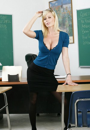 Tempting teacher in glasses Holly Sampson undressing and posing on her desk