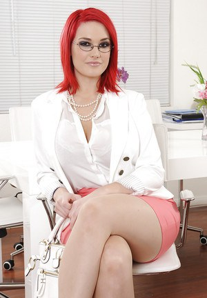 Curvy redhead vixen in glasses undressing and teasing her holes