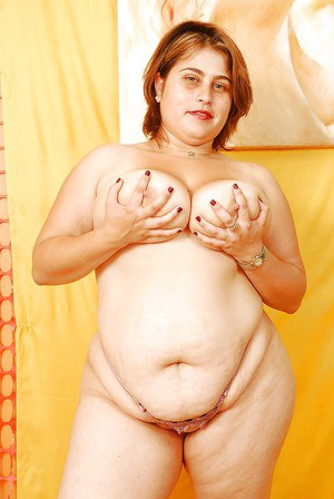 Naughty SSBBW model undressing and showcasing her flabby curves