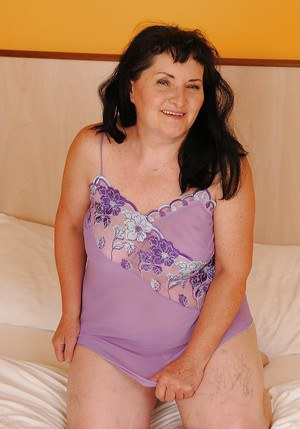 Lecherous granny taking off her lingerie and spreading her hairy lower lips