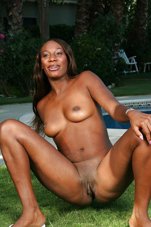Ebony lassie Misti Love taking off her lingerie and spreading her legs outdoor
