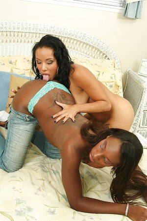 Sassy ebony lesbian has some pussy licking fun with her latina friend