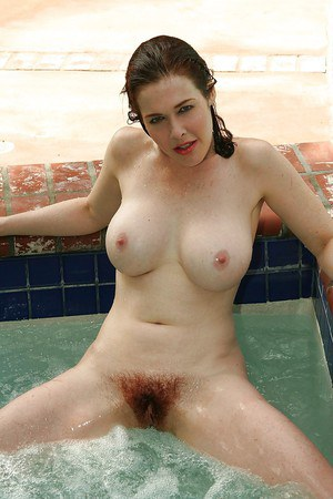 Busty mature vixen with hairy slit gets rid of her bikini at the poolside