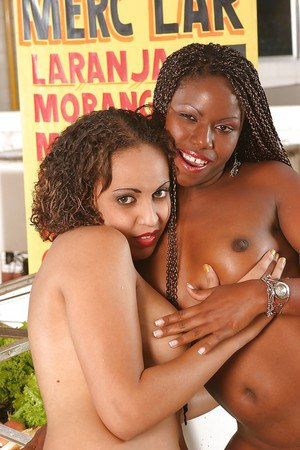 Fuckable ebony chicks pose nude and make some lesbian humping action