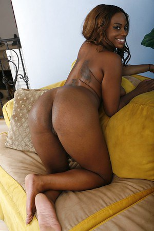 Smiley ebony vixen Tori Taylor taking off her lingerie and spreading her legs