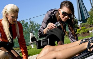 European vixens have some fully clothed lesbian pissing fun outdoor