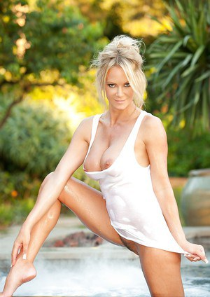 Hot blonde Barbara Moore demonstrating her gorgeous curves at the poolside