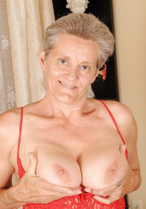 Lusty granny with big saggy jugs undressing and exposing her twat