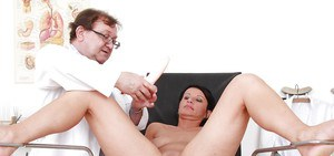 Busty mature brunette gets her pussy examed by a naughty gyno