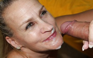 Mature blonde shows off her handjob skills for a cumshot on her smiley face