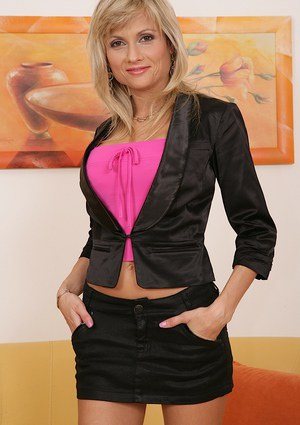 Graceful blonde MILF gets rid of her dress clothes and pink lingerie