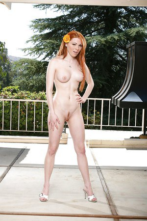 Redhead fox Jayme Langford undressing and spreading her legs outdoor
