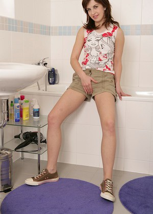 Sassy teenage amateur undressing and spreading her cunt in the bathroom