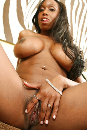 Ebony bombshell takes off her tiny bikini and gets her gorgeous butt oiled up