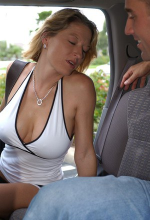 Slutty MILF with big tits Serena Stevens gives head at the back seat