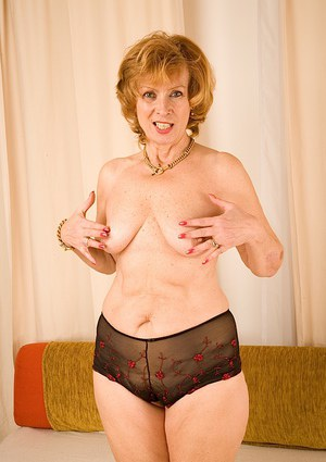 Mature gal with saggy tits and flabby belly undressing and toying her twat