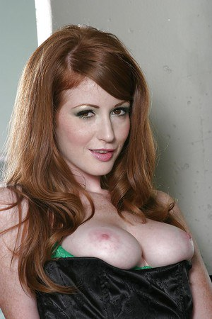 Desirable redhead babe Nikki Rhodes slipping off her sexy lingerie