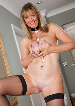 Fuckable mature blonde with stockings undressing and playing with herself