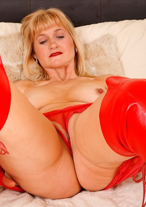 Mature blonde in red high heel boots undressing and rubbing her slit