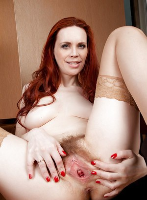 Voluptuous redhead MILF in stockings undressing and exposing her hairy gash