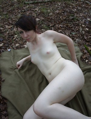 Slippy amateur with pale skin and shaved cooter posing nude outdoor