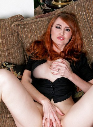 Horny redhead MILF with hot body taking off her jeans and rubbing her slit