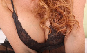 Jaw-dropping sexy MILF in lacy lingerie uncovering and exposing her goods