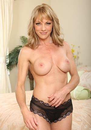 Voluptuous blonde MILF taking off her lacy lingerie and exposing her goods