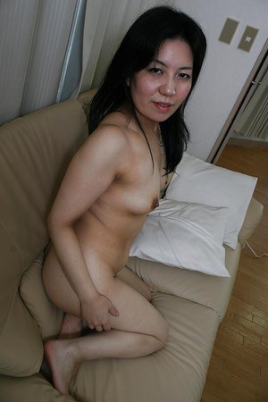 Smiley asian mature lady undressing and teasing her hairy gash