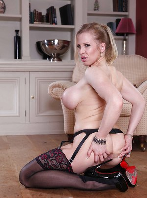 Top-heavy MILF in stockings undressing and showcasing her gash
