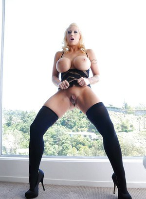 Juggy blonde getting bottomless and playing with anal beads