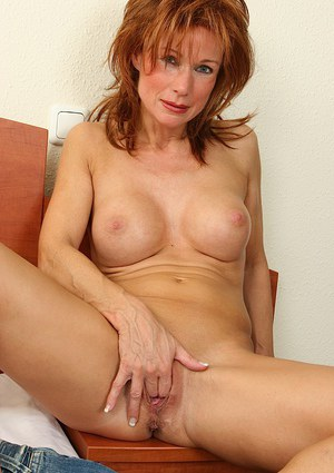 Busty mature gal in jeans undressing and fingering her cunt  in close up