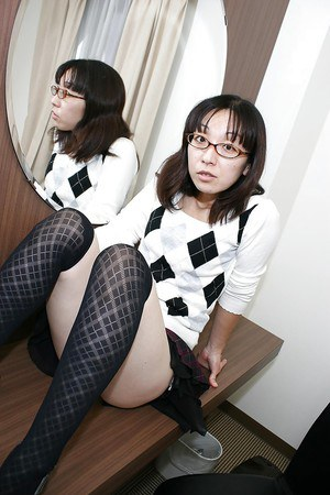 Lusty asian MILF in glasses takes off her panties and vibes her hairy gash