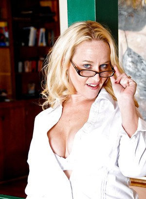 Chubby blonde MILF in stockings and glasses undressing and toying her twat