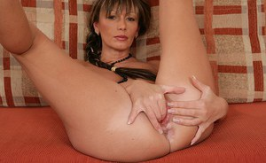 Seductive MILF in leopard outfit undressing and fingering her soaking twat
