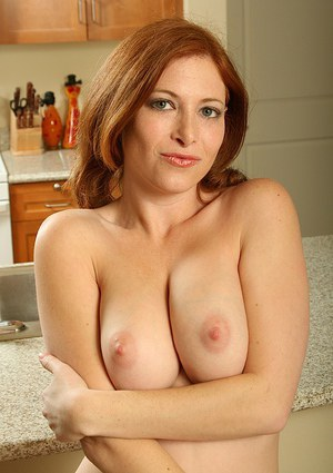 Big busted redhead MILF with hot ass getting nude and toying her twat