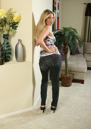 Alluring blonde MILF in jeans slowly uncovering her tempting curves