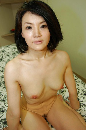 Asian MILF Saki Machida strips down and has some pussy vibing fun