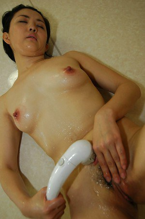 Fuckable asian MILF taking shower and teasing her hairy twat in close up