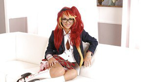 Foxy schoolgirl in glasses and fancy uniform uncovering her petite curves