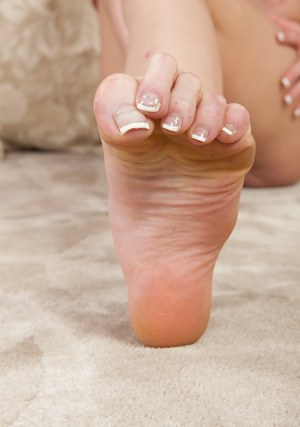 Stunning brunette amateur exposing her sexy soles and graceful body