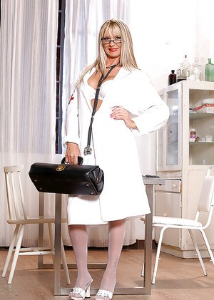 Sassy european nurse in glasses getting rid of her uniform and lingerie