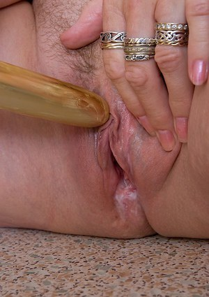 Ugly mature chick pleasing her hungry hairy twat with a vibrator