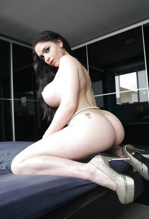 Lusty latina with jaw-dropping big round boobs gets rid of her clothes