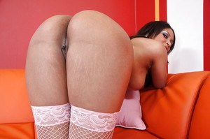 Lustful ebony gal with perky jugs and shaved cooter posing in white stockings