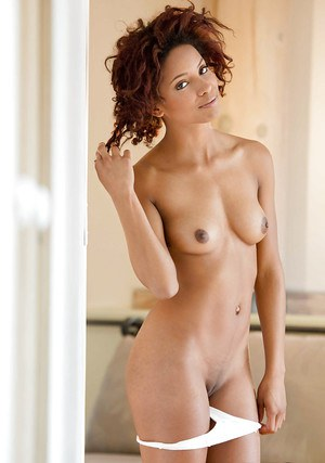 Curly-haired ebony honey in sexy lingerie undressing and exposing her goods