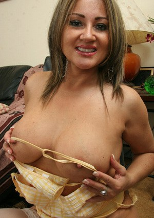 Mature latina in stockings playing with her jugs and fingering her asshole